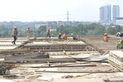 Group of construction workers fabricating floor slab reinforcement bar and formwork Stock Images