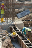 Group of construction workers fabricating ground beam formwork Stock Photos