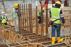 Group of construction workers fabricating ground beam formwork Stock Image