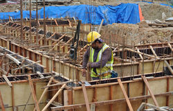 Group of construction workers fabricating ground beam formwork Stock Photography