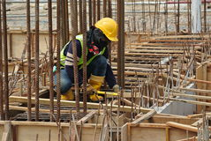 Group of construction workers fabricating ground beam formwork Royalty Free Stock Photography