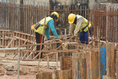 Group of construction workers fabricating ground beam steel reinforcement bar Stock Image