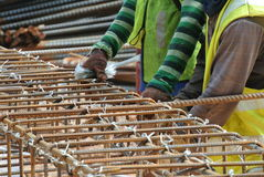 Group of construction workers fabricating pile cap steel reinforcement bar Royalty Free Stock Photography