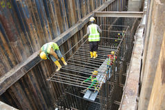 Group of construction workers fabricating pile cap steel reinforcement bar Stock Images