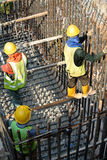 Group of construction workers fabricating pile cap steel reinforcement bar Royalty Free Stock Image
