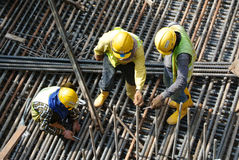 Group of construction workers fabricating steel reinforcement bar Royalty Free Stock Images