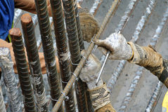 Group of construction workers fabricating steel reinforcement bar Stock Photo