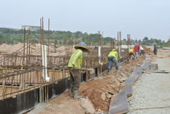 Group of construction workers installing ground be Royalty Free Stock Photography