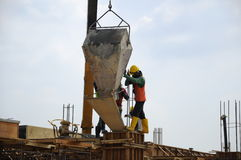 A group of construction workers pouring concrete into formwork Royalty Free Stock Photography