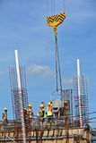 A group of construction workers pouring concrete into ground beam form work Stock Photo