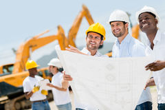 Group of construction workers Stock Images