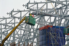 Group of construction workers standing in the mobile crane basket Stock Images