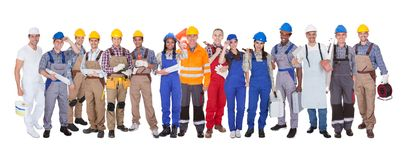 Group of construction workers. Standing Over White Background