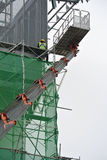 Group of construction workers using the mobile crane basket. MALAYSIA, MALAYSIA – NOVEMBER 27: 2015: Construction workers using  the mobile crane basket while Royalty Free Stock Photos