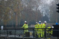 Hyde park construction. A group of construction workers at work outside londons hyde park Royalty Free Stock Photography