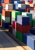 Group Containers on vertical with bright light Royalty Free Stock Photography
