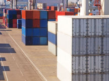 Group Containers white,blue,red stacked with bright side light royalty free stock image