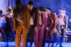 Group of contemporary dancers performing on stage Royalty Free Stock Photo