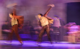 Group of contemporary dancers performing on stage Royalty Free Stock Images