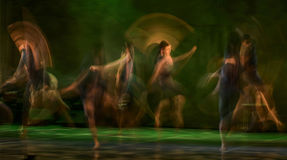 Group of contemporary dancers performing on stage Royalty Free Stock Image