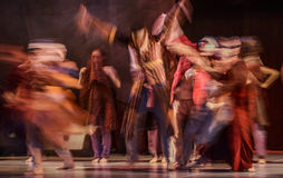 Group of contemporary dancers performing on stage Stock Images