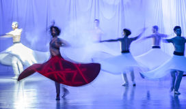 Group of contemporary dancers performing on stage stock photography