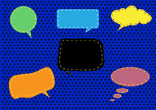 Group of conversation bubbles on blue polka dot backgrounds Royalty Free Stock Photo