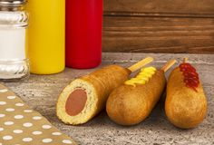 Group of corn dogs on table. Fast food restaurant. royalty free stock photo