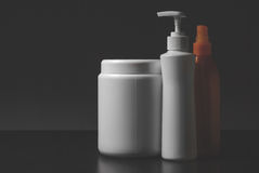 Group of cosmetic bottles on white stock photography