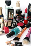 Group of cosmetics on white background. A consistent group of cosmetics in different colors, sizes and shapes (cream, perfume, eyes multi-shades with mirror lids royalty free stock image