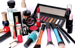 Group of cosmetics on white background. A consistent group of cosmetics in different colors, sizes and shapes (cream, perfume, eyes multi-shades with mirror lids stock photos