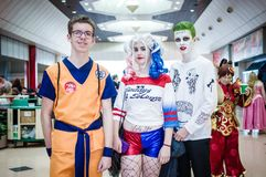 Group of cosplayers at Birmingham MCM. Birmingham, UK - November 19, 2017: Cosplayers dressed as Harley Quinn and the Joker from DC Comics and movie Suicide Stock Photography