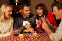 Group Of Couples Playing Cards Together Royalty Free Stock Photos