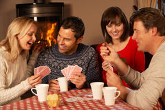 Group Of Couples Playing Cards Together Royalty Free Stock Images