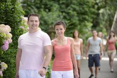 Group of couples on a walk outdoors. Happy group of couples on a walk outdoors royalty free stock photos