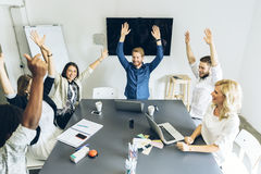 Group of coworkers happy as goal is achieved. Group of happy coworkers content as goal is achieved Royalty Free Stock Photo