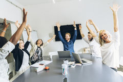Group of coworkers happy as goal is achieved. Group of happy coworkers content as goal is achieved Stock Images