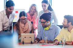 Group of coworkers using a tablet computer Stock Images