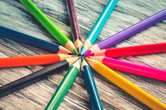 Colorful school supplies. Group of crayons on a wooden table royalty free stock photos