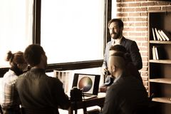 Group of creative designers discuss the color palette in a moder. Photo in retro style.a group of creative designers discussing a new color palette in the stock photography