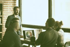 Group of creative designers discuss the color palette in a moder. Photo in retro style.a group of creative designers discussing a new color palette in the royalty free stock image