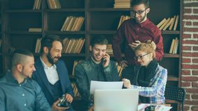 Group of creative designers discuss the color palette in a moder. Team of designers to develop new color palette in the workplace in a modern office royalty free stock photo