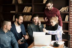 Group of creative designers discuss the color palette in a moder. Team of designers to develop new color palette in the workplace in a modern office stock images