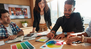 Group of creative designers discuss the color palette Stock Images