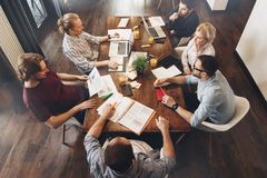 Group of creative managers sits around table. Working process. T royalty free stock photos