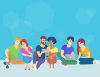 Group of creative people using smartphone, laptop and tablet pc sitting on the floor Royalty Free Stock Photography