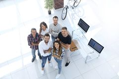 Group of creative professionals standing in office Royalty Free Stock Photos