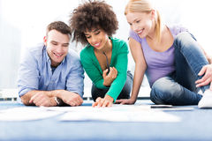 Group of creative professionals working on floor Stock Photography