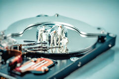 Group of criminalists inspecting hard drive Stock Images