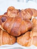 Group of croissants with jam, vanilla cream and honey Stock Photos